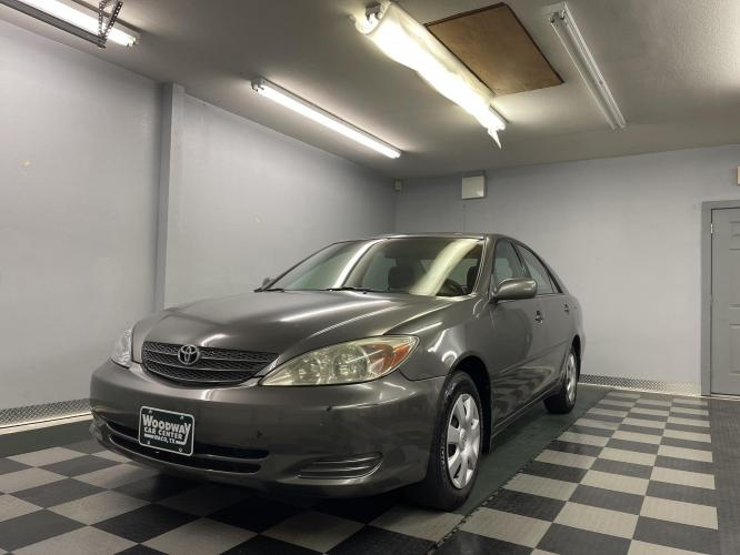 2004 Grey /Gray Cloth Toyota Camry LE (4T1BE32K34U) with an 2.4L L4 DOHC 16V engine, Automatic transmission, located at 9900 Woodway Drive, Woodway, TX, 76712, (254) 751-1444, 31.493961, -97.228523 - Photo #0